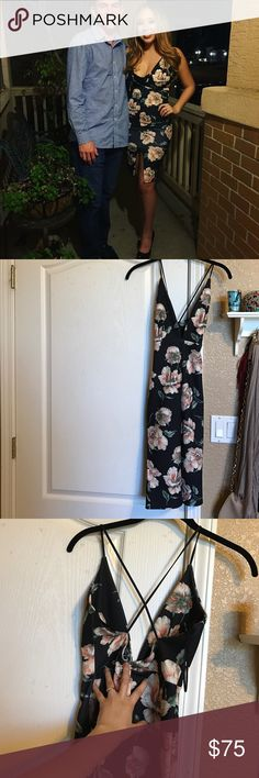 Black floral Missguided dress Only worn once. Tight fitting but super stretchy with a small slit on the bottom. Cuts down pretty low, so I wore a Bralette underneath. Criss cross back. Missguided Dresses Midi