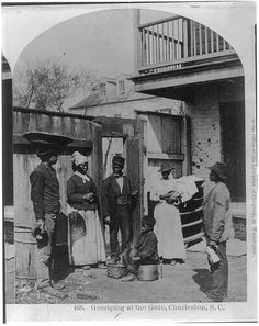 African Americans working, Charleston, S.C.: Gossiping at the gate.  c.1879