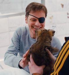 I knew he loves dogs! Kingsman 2015, Kingsman Harry, Kingsman Movie, Colin Firth, Taron Egerton Kingsman, Kingsman The Secret Service, Eggsy Unwin, Mr Darcy, Dogs