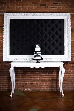 Tufted Frame good idea for guestbook table with engagement photos on it