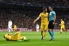 Miralem Pjanic of Juventus confronts referee Michael Oliver during the UEFA Champions League Quarter Final Second Leg match between Real Madrid and Juventus at Estadio Santiago Bernabeu on April 11, 2018 in Madrid, Spain.