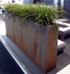 Cotten planter on the deck Outdoor Corten steel planter provides privacy and art for landscaped gardens