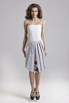 IN.NA wearing grey skirt with birds