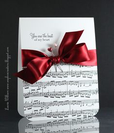 sheet music on bottom of card, highlighted with big bow and stick pins
