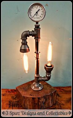Industrial pipe lamp with 2 hairpin filament bulbs and vintage gauge on top, with wood base Check out the labels ...