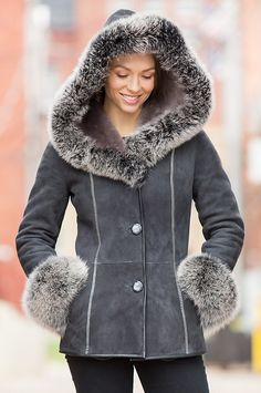 The Irma Shearling Sheepskin Jacket is crafted from supreme sheepskin leather with natural shearling lining and hood with fox fur trim.