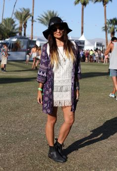Bohemian kimono, fringed lace shift, biker boots, floppy wide brim... This babe gets it so right at Coachella!