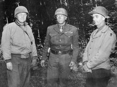 Gen George C. Patton Jr, commanding US 3rd Army, confers with two of his divisional commanders, Major-General Manton S Eddy (left) and Major-General Horace MacBride, 1944.