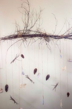 Spray paint those branches red or Christmas green and suspend pine cones and other treasures from the branches!