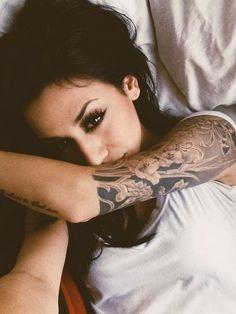 Nice Half Sleeve Tattoo in Black and Grey.