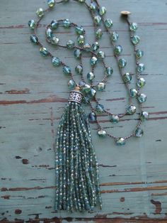 """Sea green tassel necklace Mystic Sea aqua olive by slashKnots- A sparkly glass tassel swings from a crocheted chain of striking Czech glass beads. So much movement and shine :) Perfect with a summer maxi or tank! Love this color worn with olive green..  Measures 34"""" with a 4 1/2"""" tassel drop. Loop closure with an abalone button."""