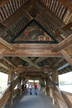 Spreuerbrucke (smaller covered bridge) with triangular paintings, Lucerne, Switzerland.  Photo: KarlGercens.com, via Flickr