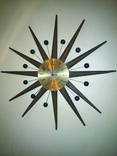 Check out this item in my Etsy shop https://www.etsy.com/listing/265434085/seth-thomas-sunburst-mid-century-clock