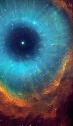 "The Helix Nebula (NGC 7293) is a large planetary nebula located in the constellation Aquarius, approx. 215 parsecs or 700 light-years distant from Earth. It was the first planetary nebula discovered to contain cometary knots, which can be seen as globs with tails around the center of the ""pupil"". There are more than 20,000 cometary knots estimated to be in the Helix Nebula. These knots remain somewhat of a mystery to astronomers. NASA/Hubble/JPL/Cal Tech"