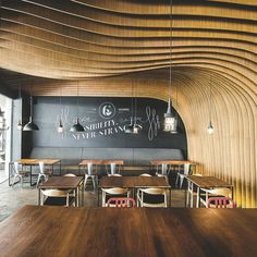 OOZN DESIGN has created cavernous cafe in Jakarta - Six Degrees Cafe using undulating timber slats around the walls and ceiling to make a memorable and cosy cafe. Monochrome Interior, Modern Interior, Interior Architecture, Interior Design, Deco Design, Cafe Design, Store Design, Restaurant Paris, Restaurant Design