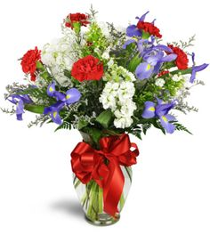 Your favorite patriot will love this gorgeous red, white, and blue floral gift! Red carnations, blue irises, and white stock blooms evoke 4th of July sentiments, Memorial Day remembrances, and good ol' summertime joy. This is the perfect gift for a returning soldier or proud family member of a service man or woman.