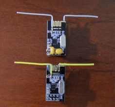 Enhance the nRF24L01 radio module with a Dipole antenna mod http://www.instructables.com/id/Enhanced-NRF24L01