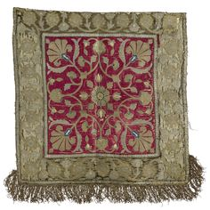 AN OTTOMAN SILK AND METAL THREAD EMBOIDERED COVER, OTTOMAN EMPIRE, the crimson satin ground worked in polychrome silk satin stitch, silver and gilt metal thread with a central flowerhead issuing carnation sprays, olive green satin border of similarly embroidered running vines and palmettes