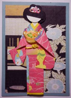 "https://flic.kr/p/yKaQjU | ATC1284 - Bringing a bowl of Japanese noodles | ATC with hand-folded Japanese origami paper doll. Traded at AFA.  Materials: Background (print of Ray Morimura's woodblock, ""Morning Glory and Tea House""); kimono and obi (origami paper); viscose cord on obi; hair decor (nail art sticker); bowl (Japanese puffy sticker)."