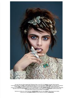 Model Zuzana Gregorova poses with bejeweled butterfly accessories and Celine lace blouse for Vogue Portugal Magazine September 2016 issue