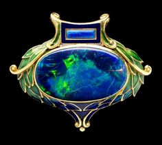 Art Nouveau brooch in enamelled gold set with opal, Marcus & Co. (New York)… by madeleine