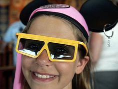 3-D GLASSES: Daphne Sandau, 10, wears the 3-D glasses required for Disney's newest ride, Toy Story Mania at California Adventure.