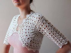 Crochetemoda: Casaqueto Branco de Crochet Shows charts.