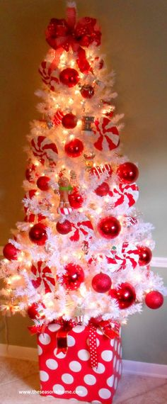 White Christmas tree with red ornaments-think this would be perfect for my office