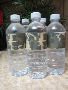 Add duct tape to water bottles for party theme. Army theme party.