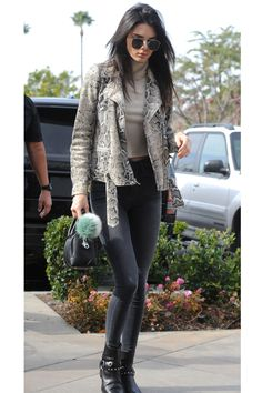 Kendall Jenner steps out in a turtleneck, snakskin bomber and black skinny jeans. See all the model's best street style looks here:   - HarpersBAZAAR.com