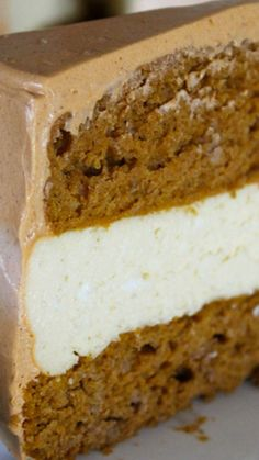 Pumpkin Spice Cake Cheesecake Recipe ~ A layer of cheesecake between two layers of pumpkin spice cake and a cinnamon spice frosting.