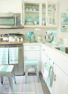 I am absolutely gushing over this sweet cottage... the mints aquas the stripes... oh MY!! Pastel Beach house Kitchen #retrohomedecor