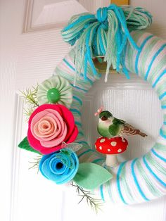mushroom yarn wreath...no directions though Blues and whites would be pretty for top...moss rocks on the bottom...