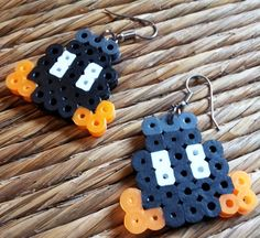 Bob Omb Earrings - perler hanna fusible bead super mario character geek nerd swag dangle fish hook FREE Shipping to United States. $7.50, via Etsy. Fuse Beads, Beads And Wire, Hama Beads Patterns, Beading Patterns, Perler Bead Mario, Nerd Crafts, Peler Beads, Iron Beads, Bead Art