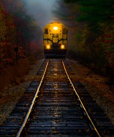Train in Rain by Derek Kind - The Notch train, part of the Conway Scenic Railroad in New Hampshire's White Mountains, on a wet fall day.