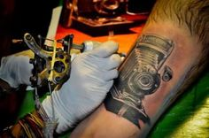 camera tattoo...this is pretty cool...but I would like to point out that wow thats a hairy leg! This might be a dumb question but do you continuously have to shave your tattoo or does it prevent hair from growing??
