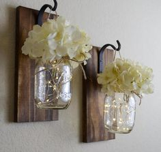 These rustic mason jar sconces are the perfect touch to any home to give it that farmhouse feel. They are handcrafted and stained in your choice of stain color (shown in 5th picture above) and then a pint sized mason jar is hung with rustic twine. This listing is for a SET OF TWO sconces
