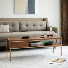 It's the SOFA that I'm looking for!  See one cushion, low arm and low back!  Anybody know where this can be found???? PLEASE!  Must have it.  Nook Rectangular Coffee Table #westelm