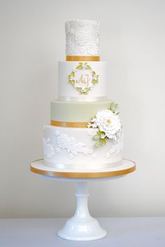 White peony, sugar lace, gold ribbon and green tier wedding cake