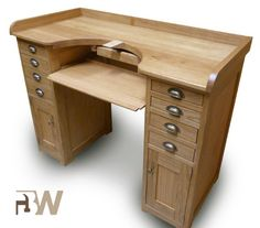 Zimmer Traditional oak workbench by Benchworks, Belgium. Two cabinets with drawers and a door on lock; dovetailed drawers; small drawer under the benchtop; retractable writing board; leather skin to catch filings; solid french oak with some parts in veneered oak, entirely finished with oil; includes 2 filing pins. Price INCL VAT:  € 1185,80