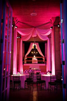 Lovely uplighting and tulle ceiling draping