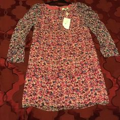 NWT Tibi two toned floral dress  brand new! long sleeve Tibi floral dress with two toned color contrast. has a pink under sleeve so it's not transparent. Also has button details on the sleeves. perfect light weight spring dress! no trades! Tibi Dresses