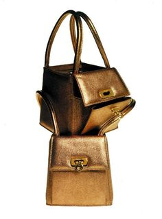 "1969 The ""Gancino"" hardware makes its debut on a Ferragamo handbag."