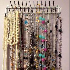 Organize long necklaces on a men's tie rack!