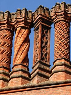 Decorative brick chimney stacks atop Hampton Court Palace. (They're Victorian but follow the original Tudor design.) Photo © The Tudor Tutor