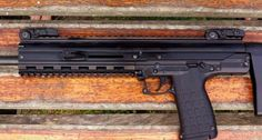 kel tec cmr 30, had two of the pmr 30s, sweet guns, looks like this is a rifle made off that pistol, great idea, i sold my two pmrs because of the difficulty in loading the 30 round mags pure torture and i would rarely ever get 30 rounds in one, lucky to make it to 25 rds, no loaders for this mag, it is a triangular shape