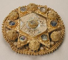 Brooch  Date: 970–1030 Geography: Made in, North Italy Culture: Ottonian Medium: Gold, pearls, glass, cloisonné enamel