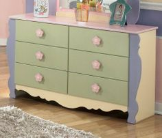 "Kids Bedroom Dresser in Multi Colored Pastels by Famous Brand Furniture. $395.25. Pink and yellow flower motif handles.. Multi colored pastels.. Inches: 50.39"" W x 16.38"" D x 29.76"" H. Matching pieces available.. Exaggerated traditional silhouette style.. Seemingly pulled straight from the pages of a fairy tale, the enchanting beauty of the ""Doll House"" youth bedroom collection is sure to magically transform the atmosphere of any child's bedroom. Bathed in charming..."