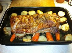 Easy to follow recipe for pork loin roast, roasted potatoes, roasted carrots and apple sauce. Pictures included.