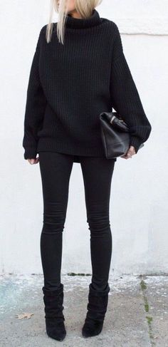 all black look with a chunky knit sweater and ankle boots